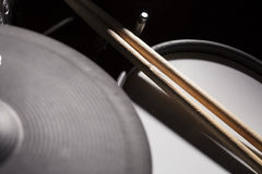 Close Up Drums. A close up shot of drumsticks on a set of electric drums stock images