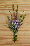 Close up of dry heather bouquet on wood background Royalty Free Stock Photography