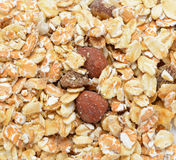 Close-up of dry muesli with nuts from above, cereal. Heap of premium fruit and nut muesli isolated on white royalty free stock photo