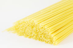 Close up of dry uncooked spaghetti lie Royalty Free Stock Images