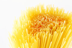 Close up of dry yellow uncooked spaghetti Royalty Free Stock Photo