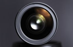 Close up of dslr zoom lens. Front element on gray studio background royalty free stock photography