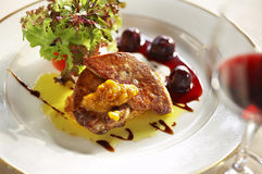 Close up duck liver grilled and cherry sauce Stock Image