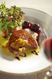Close up duck liver grilled and cherry sauce Royalty Free Stock Images