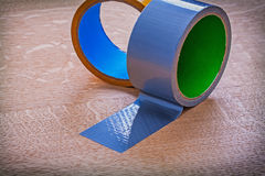Close up of duct tapes on vintage brown wooden Royalty Free Stock Images