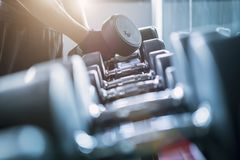 Close up of dumbbell in fitness gym sport complex. Sport, health. Y life and lifestyle concept royalty free stock image