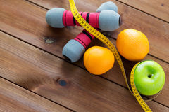 Close up of dumbbell, fruits and measuring tape Royalty Free Stock Photography