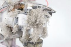Close up dust on motor electric fan and copy space. Close up dust on motor electric fan with white background and copy space. Maintenance and healthy concept stock image