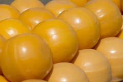 Pile of yellow cheese balls on the market royalty free stock photography