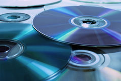 Close up of dvd discs as background. Rainbow reflection, blue light stock photos