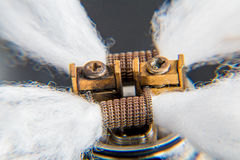 Close up on e-cigarette coils with cotton. DIY RDA Dripper Coils.nBlack isolated background in studio Royalty Free Stock Images