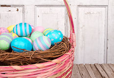 Close up of Easter basket and Easter eggs Royalty Free Stock Photography