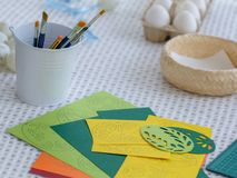 Close-up easter egg decorating and painting tools. Royalty Free Stock Photo