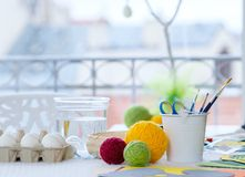 Close-up easter egg decorating and painting tools. Stock Image
