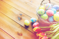 Close up of easter eggs in basket and flowers Stock Photo