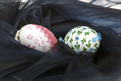 Close-up of Easter eggs on black velvet stock photo
