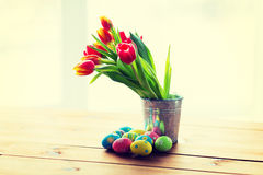 Close up of easter eggs and flowers in bucket Stock Photos