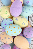 Close Up of Easter Eggs in Wire Tray for Backgrounds. Close up of painted easter eggs in a wire tray for backgrounds Stock Photos