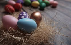 Close up Easter eggs on wooden table stock photo