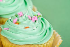 Close-up of Easter spring cupcake. With sprinkles. Green background with copy space Stock Image