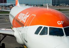 Close up of a Easyjet Airbus plane ready for passengers at Manchester Airport - Daylight 2019. An Easyjet aircraft is prepared for passengers to travel to Prague stock image
