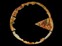 Close up of eaten pizza parts on the black background. Close up view of eaten pizza parts on the black background stock photos