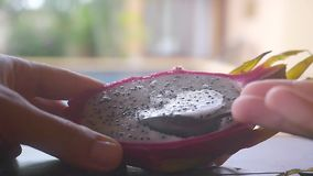Close up of eating fresh dragon fruit for dessert. Slow motion. HD, 1920x1080. Closeup of Eating Fresh Dragon Fruit for Dessert. HD, 1920x1080 stock footage