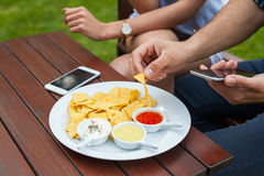 The close-up of eating tortilla-chips, there is telephone either Stock Photos
