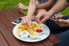 The close-up of eating tortilla-chips, there is telephone either Royalty Free Stock Photo