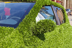 Close up of eco green grass car Royalty Free Stock Image