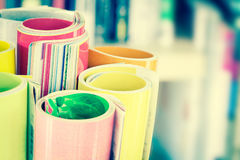 Close up edge of colorful magazine stacking roll with  blurry bo. Okshelf background for publication and publishing concept , extremely DOF with vintage retro Royalty Free Stock Images