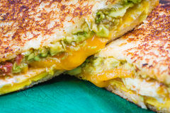 Close up egg avocado toasted sandwich. Cheese, tomatoes, avocado, egg on toasted sandwich Stock Images