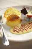 Close up egg custard with cream sauce and fruit Royalty Free Stock Photos