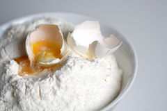 Close up of egg and flour Royalty Free Stock Photo