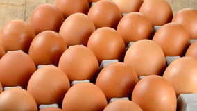 Close up egg in packet on wooden background Royalty Free Stock Image