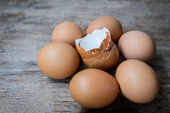 Close-up of egg shell and fresh eggs on wooden background Stock Photography