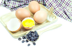 Close up egg on table cloth in wooden plate Royalty Free Stock Images