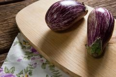 Eggplant on chopping board Royalty Free Stock Images