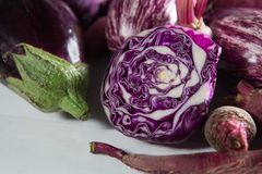 Close-up of eggplants with red cabbage. On table Royalty Free Stock Photos