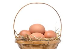 Close up eggs in bamboo basket isolated on white background. Chicken eggs for health gift Stock Photos