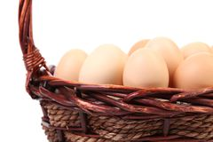 Close up of eggs into basket. Space for text. Stock Photo