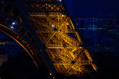 Close-up of Eiffel Tower arch at blue evening dusk Royalty Free Stock Photography