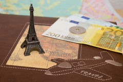 Eiffel tower with money. Close-up Eiffel tower on travel book with money background Stock Photo