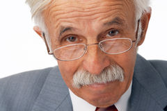 Close-up Of Elder Businessman. Close-up portrait of an elder businessman in the glasses  looking at you Stock Photography