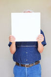 Close up of elder man holding blank canvas. room for text Royalty Free Stock Photography