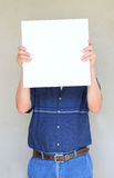Close up of elder man holding blank canvas. room for text. Stock Image