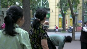 Close up from Elderly ladies working out down town Hanoi City in the morning stock footage