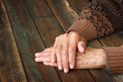 Close up of elderly male hands on wooden table Stock Image