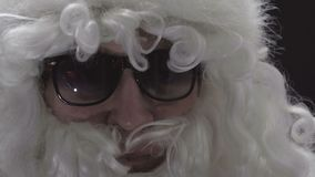 Close-up of an elderly man. Face of actor in santa suit stock footage
