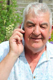 Close up of elderly man with a mobile phone. Royalty Free Stock Photo
